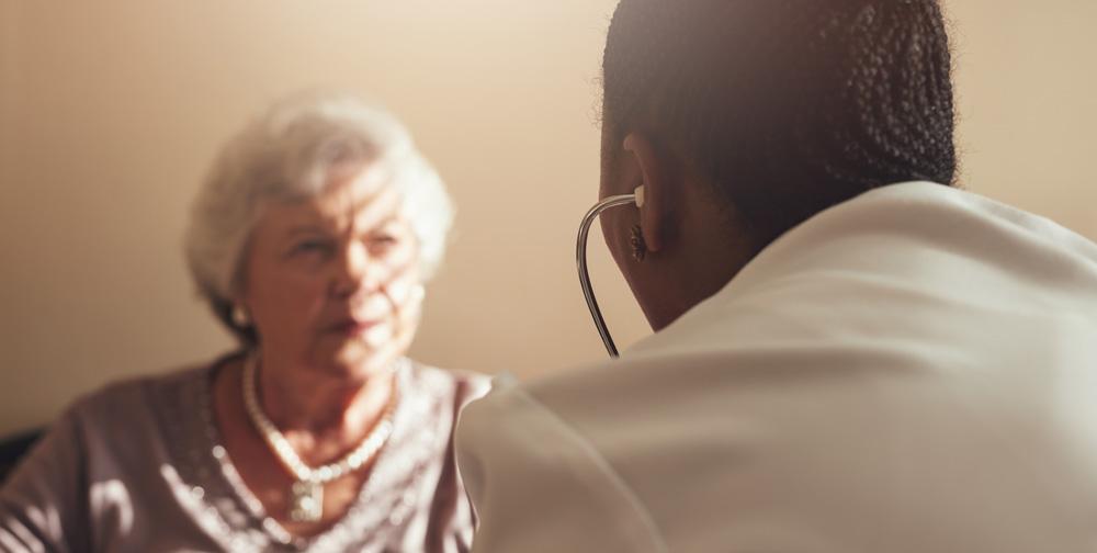 female-doctor-examining-senior-patient